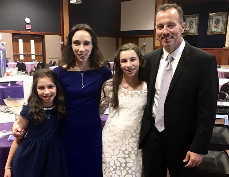 """""""I grew up in a large Jewish community in Miami Beach. My husband Tim was raised in a small town in Kansas. """"When we moved to the area, we looked for a temple where we felt a strong connection to the Jewish community and a truly welcoming environment. We found both at B'nai Jehudah. We lend our support so that our girls and other children will have the opportunity to grow up at our temple."""""""